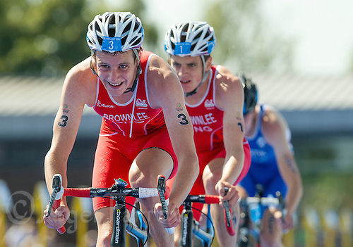 24 JUL 2014 - GLASGOW, GBR - Alistair Brownlee (ENG) (left) from England leads the front pack of his team mate and brother Jonathan Brownlee (centre) and Scotland's Marc Austin (SCO) (right) during the bike at the elite men's 2014 Commonwealth Games triathlon in Strathclyde Country Park, in Glasgow, Scotland (PHOTO COPYRIGHT &copy; 2014 NIGEL FARROW, ALL RIGHTS RESERVED)<br /> *******************************<br /> COMMONWEALTH GAMES <br /> FEDERATION USAGE <br /> RULES APPLY<br /> *******************************