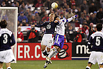 10 February 2006: US forward Taylor Twellman (20) and Japan's Tsuneyatsu Miyamoto (5) challenge for a ball in the air. The United States Men's National Team defeated Japan 3-2 at SBC Park in San Francisco, California in an International Friendly soccer match.