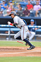 Rome Braves second baseman Jordan Rodgers (15) runs to first base during a game against the Asheville Tourists at McCormick Field on June 24, 2017 in Asheville, North Carolina. The Tourists defeated the Braves 6-5. (Tony Farlow/Four Seam Images)