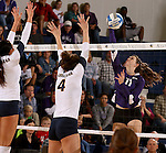 SIOUX FALLS, SD - OCTOBER 14: Courtney Ysker #9 and Becca Finley #4 from Augustana looks to block a kill attempt by Kate Hart #11 from the University of Sioux Falls in the first game of their match Tuesday night at the Elmen Center. (Photo by Dave Eggen/Inertia)