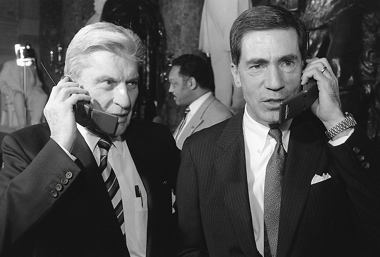 1/23/96.STATE OF THE UNION--Sens. John Warner, R-Va., and Chuck Robb, D-Va., are interviewed by cell phone in Statuary Hall after the State of the Union Address. Jesse Jackson is being interviewed in the background..CONGRESSIONAL QUARTERLY PHOTO BY SCOTT J. FERRELL