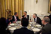 President Barack Obama talks with House Minority Leader Nancy Pelosi, House Speaker John Boehner, and Senate Majority Leader Harry Reid during a dinner with chairmen and ranking Members of Congress in the East Room of the White House, May 2, 2011. .Mandatory Credit: Pete Souza - White House via CNP