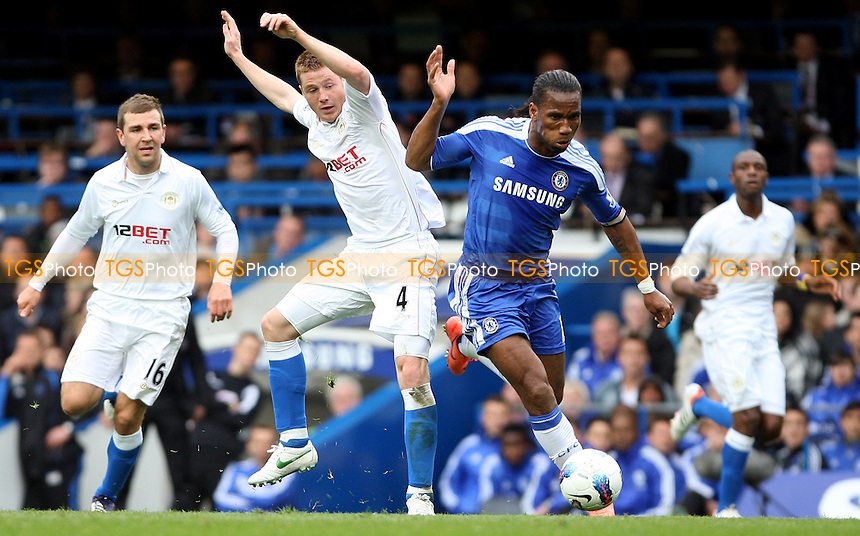 Didier Drogba of Chelsea and James McCarthy of Wigan - Chelsea vs Wigan Athletic - Barclays Premier League at Stamford Bridge, Chelsea - 07/04/12 - MANDATORY CREDIT: Rob Newell/TGSPHOTO - Self billing applies where appropriate - 0845 094 6026 - contact@tgsphoto.co.uk - NO UNPAID USE..