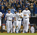 (L-R) Johnny Giavotella, Norichika Aoki, Erik Kratz (Royals),<br /> OCTOBER 5, 2014 - MLB :<br /> Johnny Giavotella, Norichika Aoki and Erik Kratz of the Kansas City Royals celebrate after winning the American League Division Series (ALDS) Game 3 against the Los Angeles Angels at Kauffman Stadium in Kansas City, Missouri, United States. (Photo by AFLO)