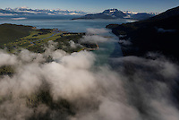 Estuaries are shrouded in morning fog in the direction of Lion's Head in the Tongass National Forest.  Water flows into the Lynn Canal in Alaska's Southeast.