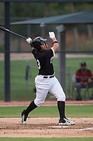 AZL White Sox right fielder Anthony Coronado (13) follows through on his swing during an Arizona League game against the AZL Diamondbacks at Camelback Ranch on July 12, 2018 in Glendale, Arizona. The AZL Diamondbacks defeated the AZL White Sox 5-1. (Zachary Lucy/Four Seam Images)