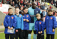 Adebayo Akinfenwa of Wycombe Wanderers poses for a picture with the Morecambe ball boys after the Sky Bet League 2 match between Morecambe and Wycombe Wanderers at the Globe Arena, Morecambe, England on 29 April 2017. Photo by Stephen Gaunt / PRiME Media Images.