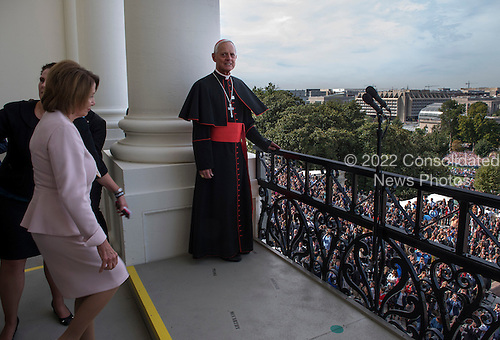Cardinal Archbishop Donald Wuerl, right, takes his place on the Speaker's Balcony followed closely by Rep. Nancy Pelosi(D-CA).  They are being joined by Pope Francis along with House and Senate leadership as well as local clergy gather on the balcony of the Speaker of the House after the Pope delivered an address to a joint session of Congress on September, 24, 2015 in Washington, DC.<br /> Credit: Bill O'Leary / Pool via CNP