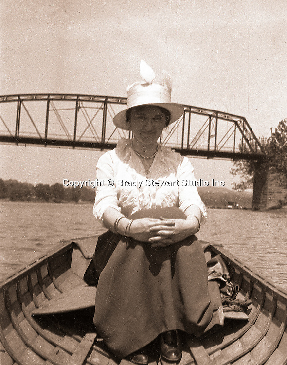 Pittsburgh PA:  Sarah Mathews Stewart in a row boat on the Allegheny River - 1915. The Ohio Connection Railroad bridge is in the background.