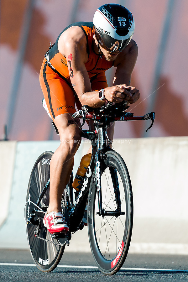 MELBOURNE, March 21, 2015 - Christian KRAMER (GER) #13 on the bike leg of the 2015 IRONMAN Asia-Pacific Championship in Melbourne, Australia on Sunday March 21, 2015. (Photo Sydney Low / sydlow.com)