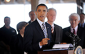 "United States President Barack Obama makes remarks about job creation and energy efficiency after he and former U.S. President Bill Clinton toured a ""trophy"" office building at 815 Connecticut Avenue, NW, on Friday, December 2, 2011 in Washington, DC.  Obama has recruited Clinton and major corporations including 3M Co. and Alcoa Inc. in a $4 billion initiative to cut energy costs in buildings and encourage hiring for construction jobs.  To date, the energy efficiency measures in this building that have been completed are saving almost $200,000 per year, or over $0.99 per square foot. .Credit: Olivier Douliery / Pool via CNP"