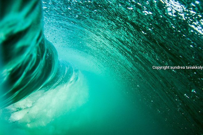 An underwater view of a breaking wave, Zuma Beach, California