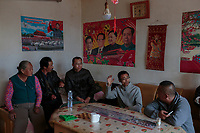 Local farmers, who are practising eco-agriculture, have a meeting at a room decorated with posters of Chinese leaders in Alxa Left Banner, Inner Mongolia, China, October 2017.