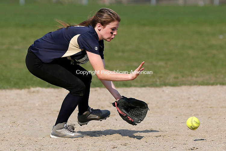 Torrington, CT- 04 May 2015-050415CM10-  Wolcott Tech's Alicia Winn braces for a grounder during their softball matchup against Kaynor Tech in Torrington on Monday.  Kaynor won,13-11.   Christopher Massa Republican-American