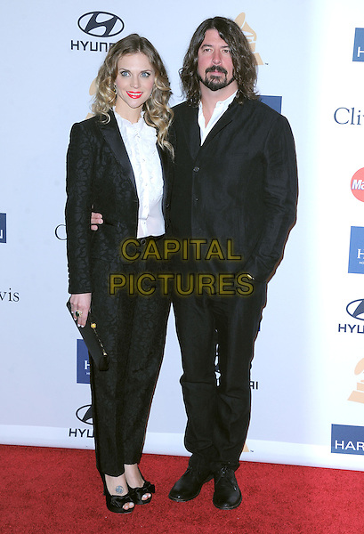 Jordyn Blum Grohl & Dave Grohl.at The  Pre-GRAMMY Gala & Salute to Industry Icons with Clive Davis Honoring Antonio L.A. Reid held at The Beverly Hilton Hotel in Beverly Hills, California, USA, February 9th 2013.                                                               .full length black jacket suit white shirt husband wife couple married arm around patterned suit peep toe shoes bows tattoo on foot clutch bag .CAP/DVS.©Debbie VanStory/Capital Pictures.