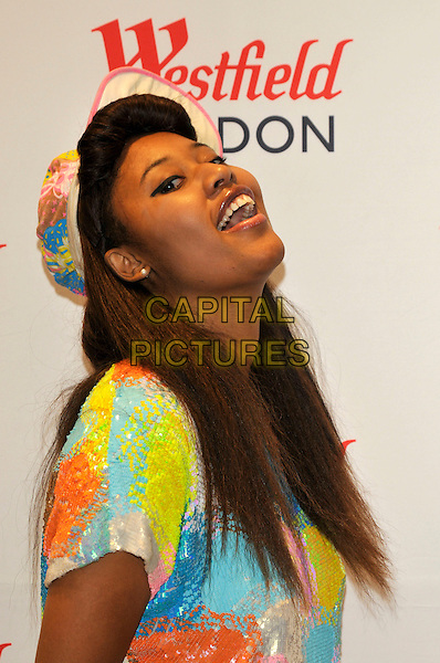 VV BROWN aka VANESSA BROWN .personal appearance at Westfield shopping centre, .Shepherds Bush, London, England, UK,.30th July 2009..PA photocall half length cap hat blue yellow orange patterned sequined beaded print dress fringe funny head back mouth open .CAP/PL.©Phil Loftus/Capital Pictures