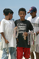 Local kids sell trinkets and necklaces on Roatan's West Bay beach.