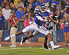 Oct 14, 2010; Lawrence, KS, USA; Kansas Jayhawks wide receiver Christian Matthews (12) can't make the catch as Kansas State Wildcats cornerback Stephen Harrison (8) provides coverage in the first half at Memorial Stadium. Mandatory Credit: Denny Medley-US PRESSWIRE