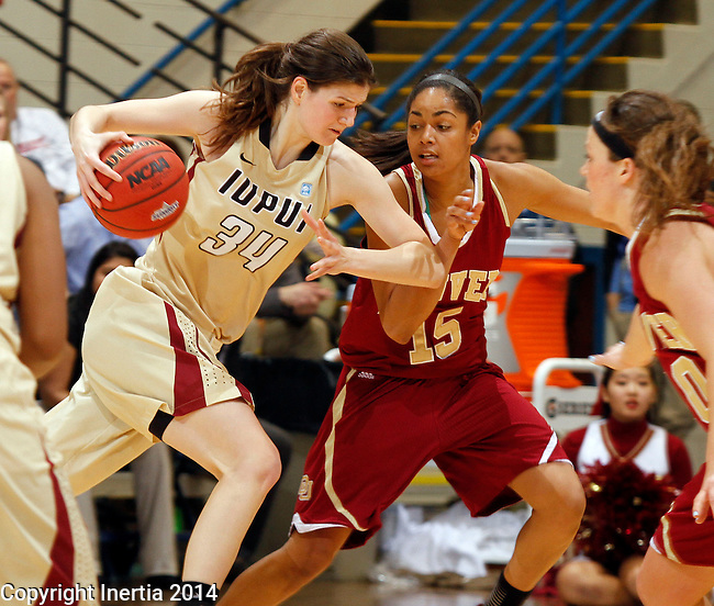 SIOUX FALLS, SD - MARCH 10:  Nevena Markovic #34 from IUPUI drives against Alecia Espinoza #15 from Denver in the second half of their semifinal game at the 2014 Summit League Basketball Championships Monday at the Sioux Falls Arena(Photo by Dave Eggen/Inertia)