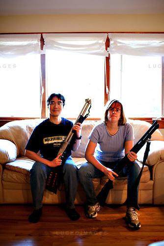 Diana Mertz Hsieh, philosophy grad student, and her husband Dr. Paul Hsieh, radiologist, and their shotguns.