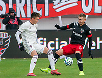 WASHINGTON, DC - FEBRUARY 29: Russell Canouse #4 of DC United and Sam Vines #13 of the Colorado Rapids clash during a game between Colorado Rapids and D.C. United at Audi Field on February 29, 2020 in Washington, DC.