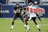 24 September 2011:  FIU wide receiver Glenn Coleman (10) attempts to evade ULL cornerback Melvin White (22) in the second quarter as the University of Louisiana-Lafayette Ragin Cajuns defeated the FIU Golden Panthers, 36-31, at FIU Stadium in Miami, Florida.
