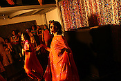 Young Indian women dance at a pre-wedding party in New Delhi, India. Photo: Sanjit Das/Panos