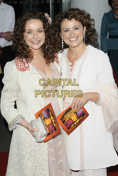 JULIA SAWALHA & NADIA SAWALHA.Royal Film Premiere of 'Arabia 3D' at the BFI Imax cinema, Waterloo, London, England, UK, May 24th 2010 ..half length pink dress white coat cream brocade patterned pattern red collar silver clutch bag sisters family siblings pale  tunic top .CAP/CAN.©Can Nguyen/Capital Pictures.