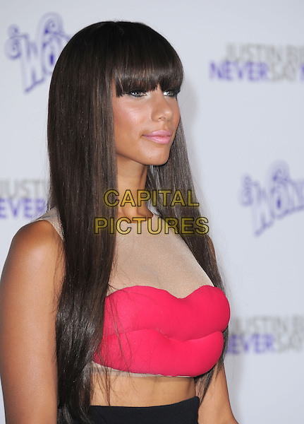 "LEONA LEWIS .attending the Paramount Pictures' L.A. Premiere of ""Justin Bieber: Never Say Never"" held at The Nokia Theater Live in Los Angeles, California, USA,.February 8th 2011..half length red pink lips dress cut out midriff mesh flesh beige sleeveless fringe profile side mouth .CAP/RKE/DVS.©DVS/RockinExposures/Capital Pictures."