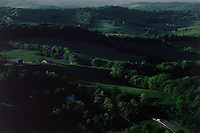 A car passes through the hilly terrain of a rural section of the National Road in Western Pennsylvania. The aerial was shot a few miles east of Scenery Hill. Construction began in Cumberland, MD in 1811 on the National Road, America's first highway built with federal funds.