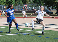 In a National Women's Soccer League Elite (NWSL) match, Portland Thorns FC defeated the Boston Breakers, 2-1, at Dilboy Stadium on July 21, 2013.  Portland Thorns FC defender Nikki Marshall (7) kicks the ball away from the  Thorns goal line as Boston Breakers midfielder Mariah Nogueira (20) approaches.
