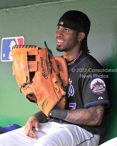 New York Mets shortstop Jose Reyes (7) holds an oversize glove in the dugout prior to the game against the Washington Nationals at Nationals Park in Washington, D.C. on Wednesday, May 19, 2010..Credit: Ron Sachs / CNP.(RESTRICTION: NO New York or New Jersey Newspapers or newspapers within a 75 mile radius of New York City)