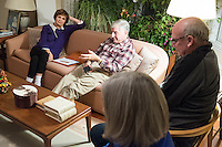 Former Massachusetts governor Michael Dukakis (on couch, right) and his wife Kitty Dukakis (on couch, left) lead a regular support group for people and their family who have had or are thinking about undergoing electroconvulsive therapy (ECT) in their home in Brookline, Massachusetts, USA, on Sun., Dec. 4, 2016. Kitty Dukakis used ECT to treat depression and substance abuse issues. She continues to have ECT treatments about once every seven or eight weeks.