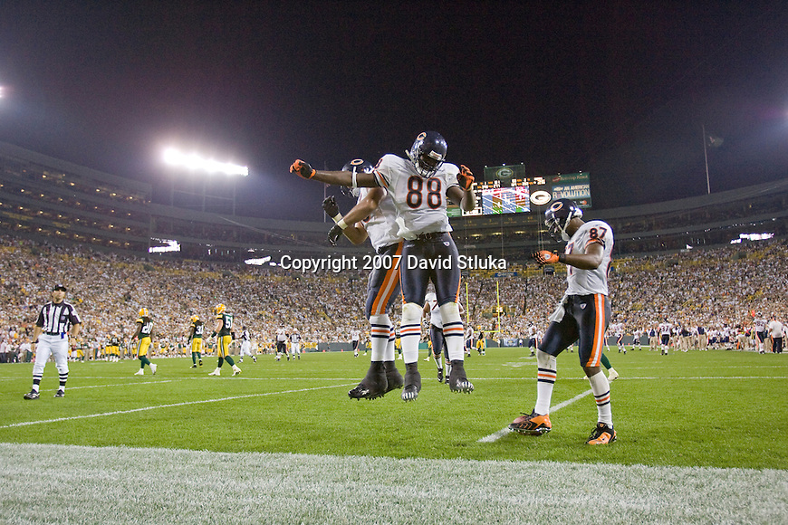 Tight end Desmond Clark #88 celebrates the winning touchdown during an NFL football game against the Green Bay Packers at Lambeau Field on October 7, 2007 in Green Bay, Wisconsin. The Bears beat the Packers 27-20. (Photo by David Stluka)
