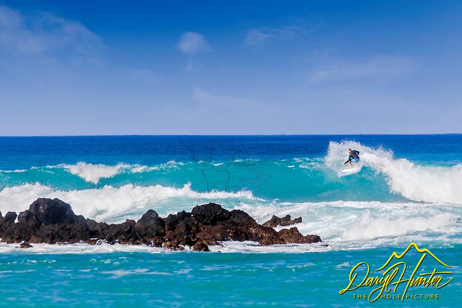 Surfing Waialea Beach on the Big Island of Hawaii.