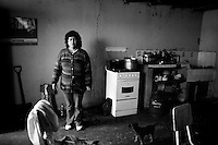 Earthquake aftermath, .Independencia Peru.<br /> People such as this woamn are afraid to sleep in their adobe homes because of the cracked walls due to the earthquake.