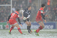 Toby Flood of Leicester Tigers (centre) passes during the Heineken Cup 6th round match between Leicester Tigers and Stade Toulousain at Welford Road on Sunday 20th January 2013 (Photo by Rob Munro).