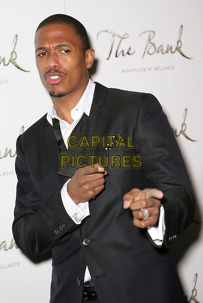NICK CANNON .celebrates his 29th birthday at Bank Nightclub inside the Bellagio Resort Hotel and Casiino, Las Vegas, Nevada, USA, 10th October 2009..half length black suit fingers pointing gesture bow tie undone white shirt .CAP/ADM/MJT.© MJT/AdMedia/Capital Pictures.