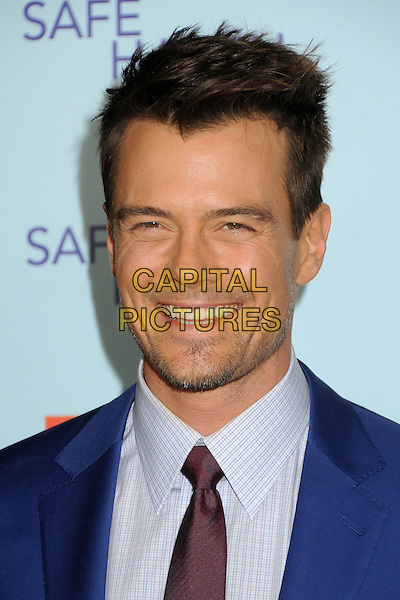 """Josh Duhamel.""""Safe Haven"""" Los Angeles Premiere held at the TCL Chinese Theatre, Hollywood, California, USA..February 5th, 2013.headshot portrait purple tie shirt blue suit stubble facial hair smiling .CAP/ADM/BP.©Byron Purvis/AdMedia/Capital Pictures."""
