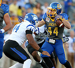 BROOKINGS, SD - OCTOBER 10:  Brady Mengarelli #44 from South Dakota State looks to make a move past Kendall Walker #44 from Indiana State in the first half of their game Saturday night at Coughlin Alumni Stadium. (Photo by Dave Eggen/Inertia)