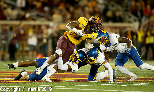 MINNEAPOLIS, MN - AUGUST 29: A trio of defenders from South Dakota State University gang up and bring down Rodney Smith #1 from the University of Minnesota during their game Thursday night at TCF Bank Stadium in Minneapolis, MN. (Photo by Dave Eggen/Inertia)