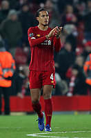 5th November 2019; Anfield, Liverpool, Merseyside, England; UEFA Champions League Football, Liverpool versus Genk; Virgil van Dijk of Liverpool returns the applause from the supporters after the final whistle - Editorial Use