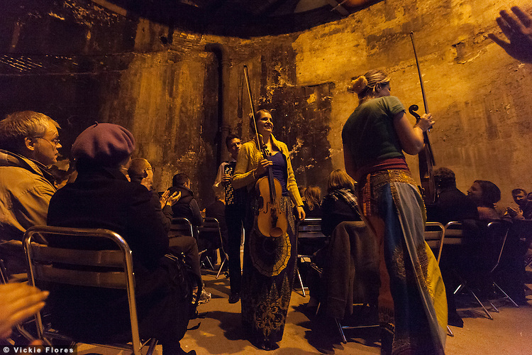 Kosmos Ensemble play in the Thames Tunnel shaft at the Brunel Museum in Rotherhithe, South East London on 18 October 2012. Harriet Mackenzie (violin), Meg Hamilton (viola) and Milos Milivojevic (accordion).