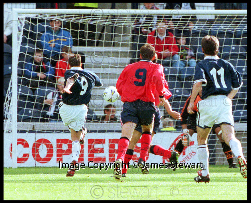 12th September 98      .Copyright Pic : James Stewart   .RAITH ROVERS V FALKIRK.CRAIG DARGO (9) SCORES THE EQUALISER FOR RAITH.........Payments to :-.James Stewart Photo Agency, Stewart House, Stewart Road, Falkirk. FK2 7AS      Vat Reg No. 607 6932 25.Office : 01324 630007        Mobile : 0421 416997.If you require further information then contact Jim Stewart on any of the numbers above.........
