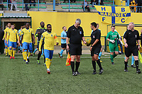 Players enter onto the pitch during Haringey Borough vs Stanway Rovers, Emirates FA Cup Football at Coles Park Stadium on 25th August 2018