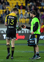 Dane Coles (right) hands Jordie Barrett the kicking tee during the Super Rugby match between the Hurricanes and Crusaders at Westpac Stadium in Wellington, New Zealand on Saturday, 15 July 2017. Photo: Dave Lintott / lintottphoto.co.nz