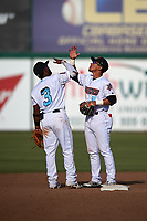 Inland Empire 66ers infielders Luis Rengifo (3) and Jahmai Jones (8) celebrate a victory after a California League game against the Lancaster JetHawks at San Manuel Stadium on May 20, 2018 in San Bernardino, California. Inland Empire defeated Lancaster 12-2. (Zachary Lucy/Four Seam Images)