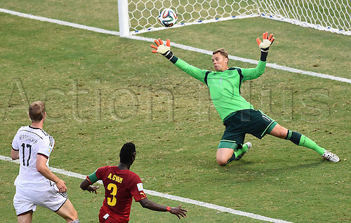 21.06.2014. Fortaleza, Brazil. Ghana's Asamoah Gyan (C) scores the goal for 1-2 against Germany's Per Mertesacker (L) and goal keeper Manuel Neuer during the FIFA World Cup 2014 group G preliminary round match between Germany and Ghana at the Estadio Castelao Stadium in Fortaleza, Brazil, 21 June 2014.