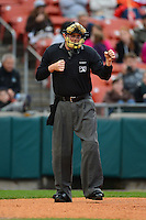 Umpire Chad Whitson makes a call during the second game of a double header between the Buffalo Bisons and Lehigh Valley IronPigs on June 7, 2013 at Coca-Cola Field in Buffalo, New York.  Lehigh Valley defeated Buffalo 4-0.  (Mike Janes/Four Seam Images)