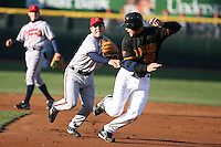 April 15th 2008:  Infielder J.C. Holt (1) of the Richmond Braves, Class-AAA affiliate of the Atlanta Braves, tags Garrett Jones (50) during a double play attempt in the 2nd inning vs. the Rochester Red Wings at Frontier Field in Rochester, NY.  Photo by:  Mike Janes/Four Seam Images